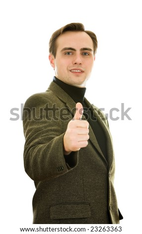 Smiling young man showing thumb-up. Isolated studio shot. Shallow DoF - focus on eyes. - stock photo