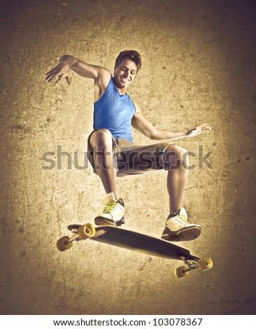 Smiling young man skateboarding