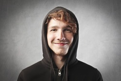Smiling young man wearing a hooded sweater