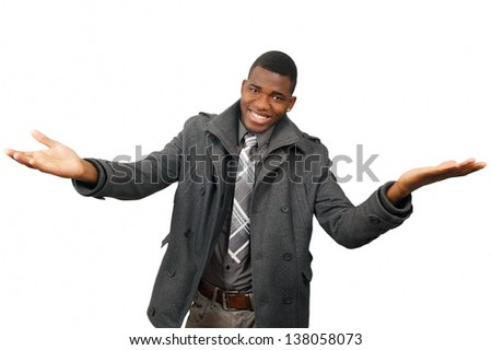 Smiling young man with arms outstretched gesture