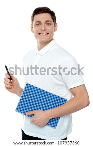 Smiling young man with notepad and pen against white background