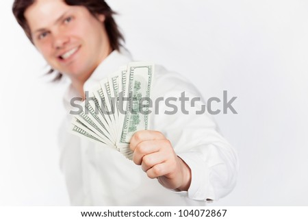 Smiling young men holding dollars in hands