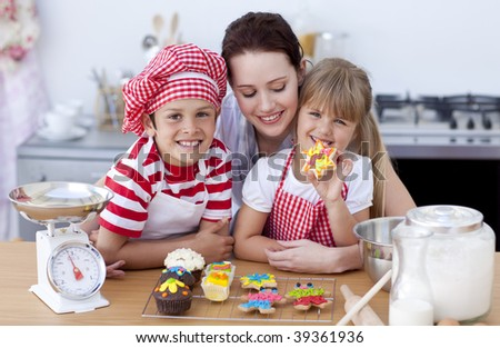 Smiling young mother and children baking in the kitchen