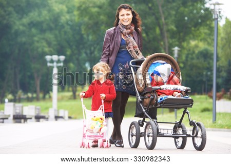5510ee0b0243 Free photos Happy mother walking with baby stroller in park