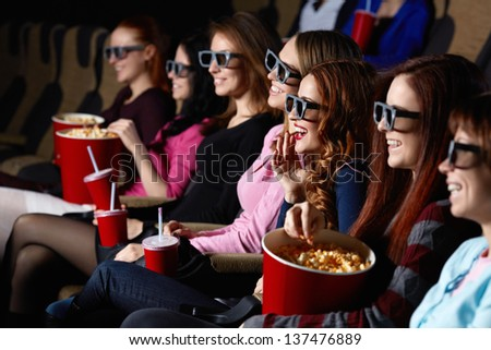 Smiling young people in the cinema