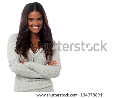 Smiling young pretty latin woman posing with her arms crossed. #134978891