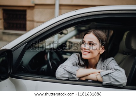 Smiling young pretty woman in the car #1181631886
