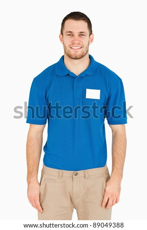 Smiling young salesman against a white background