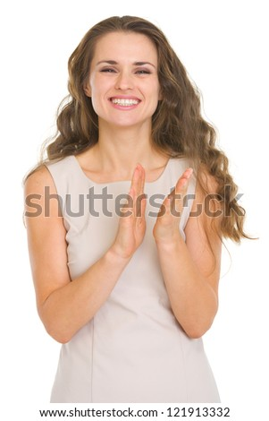 Smiling young woman applauding