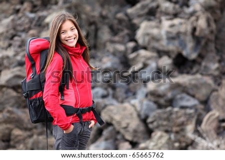 Smiling young woman hiker hiking outdoors. Portrait of mixed race Asian / Caucasian model. Photo from Teide, tenerife.