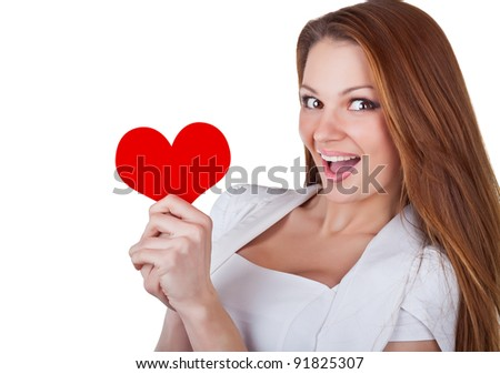 Smiling young woman holding a heart, isolated on white background