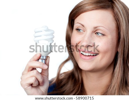 Smiling young woman holding a light bulb against white background