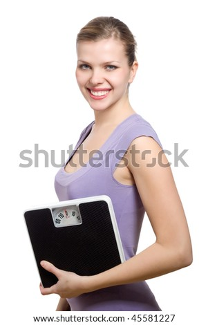 smiling young woman holding a weight scale over white background