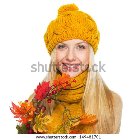 Smiling young woman holding autumn bouquet #149481701