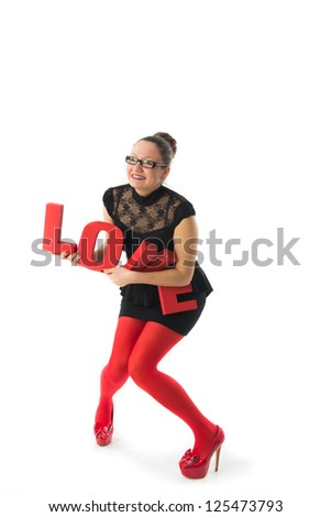 smiling young woman holds a large 3d letters love.celebrating Valentines Day