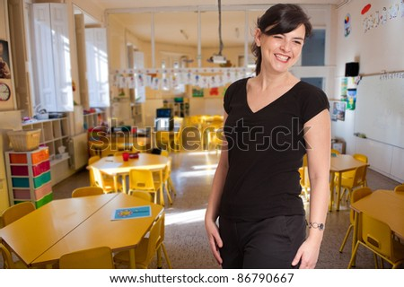 Smiling young woman  in an elementary school classroom