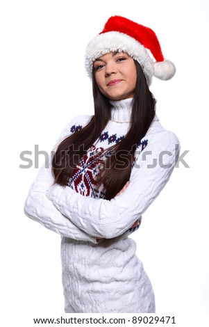 Smiling young woman in red christmass hat at white background