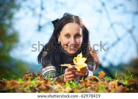 smiling young woman on meadow with evening light