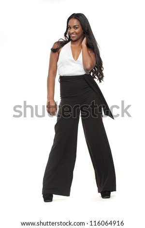 Smiling young woman posing against white background
