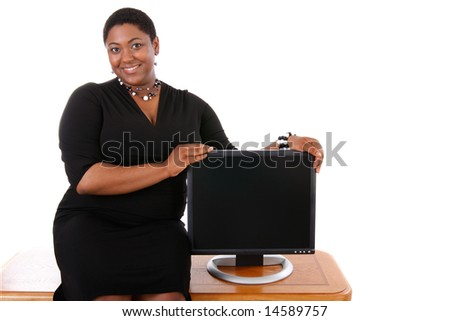 Smiling Young Woman Presenting with Computer Monitor