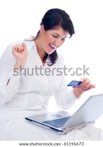 Smiling young woman with credit card and laptop isolated