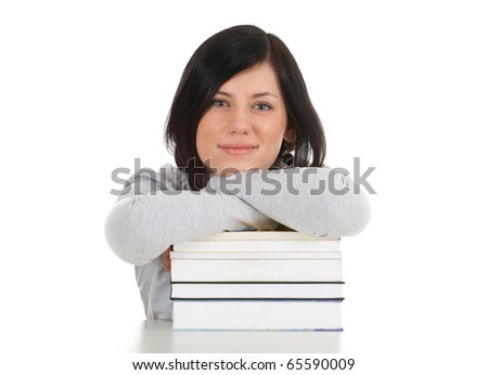 smiling young woman with stack of books