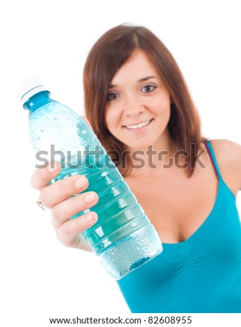 Smiling young woman with water. Isolated over white background