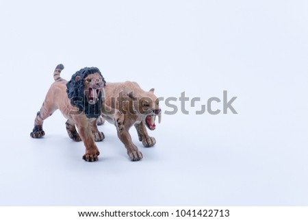 Smilodon saber-toothed two roaring and in attack position fighting with white background front view #1041422713