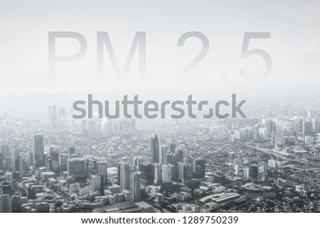 Smog city from PM 2.5 dust. Cityscape of buildings with bad weather and air pollution. PM 2.5 concept for background or copy space, black and white.