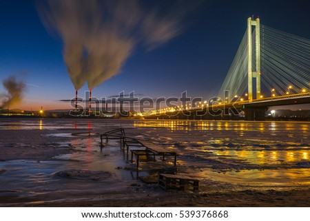 Smog from power plant near the Dnipro river on night city background, Kiev, Ukraine. Air pollution concept
