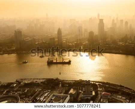 smog lies over the skyline of...
