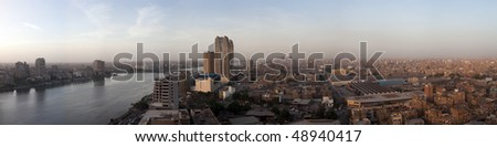 Smoggy evening panorama across Cairo in Egypt with the river Nile