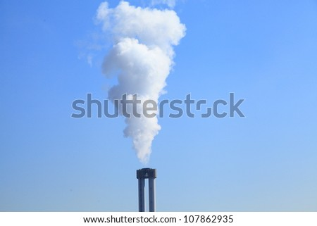 Smoke against blue sky (Center)