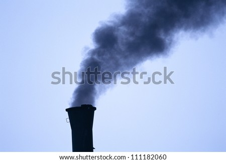 Smoke and a chimney stack in the coal industry