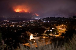 Smoke and flames of the Blue Ridge Fire engulf the hills above Yorba Linda, California, USA.
