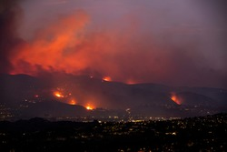 Smoke and flames of the Blue Ridge Fire engulf the hills above Yorba Linda, California, USA.