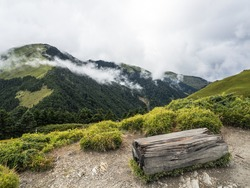 Smoke and fog over the landscapes. beautiful mountains with blue sky. wooden chair for taking a rest