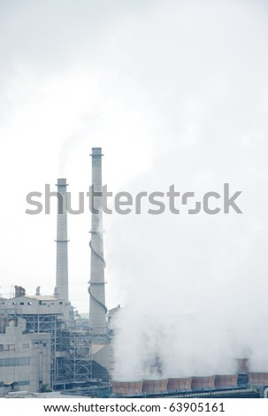 Smoke and haze surrounding the smokestacks