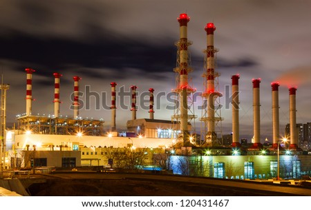 smoke and pipe plant with red lights at night sky