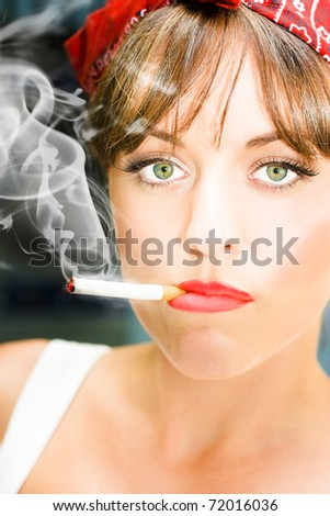 Smoke And Toxic Fumes Smolder From The End Of A Cigarette Butt Sitting In The Mouth Of A Unhappy Woman Smoker Staring With A Miserable And Sad Expression