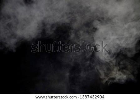 smoke blow isolated on dark background  #1387432904