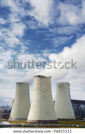 Smoke coming out of the big chimneys - stock photo