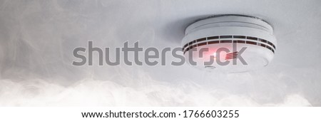 Smoke detector on the ceiling in case of fire alarm due to smoke as fire protection warning Photo stock ©