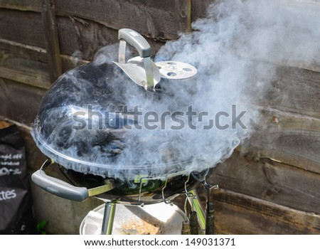 Smoke escaping from a cooking BBQ