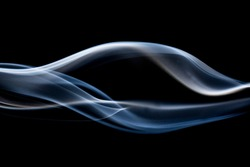 smoke floating on a black background.