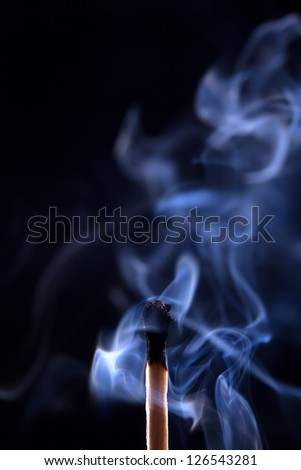 Smoke from a match that was just put out, isolated on black