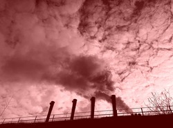 Smoke from chimney. Gloomy dramatic sky, dreary industrial landscape, toxic smoke from factory chimneys, air pollution, fear, horror, depression, decline, apocalypse, end of the world.