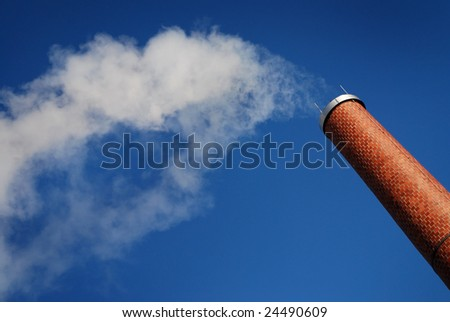 smoke from factory chimney on blue sky