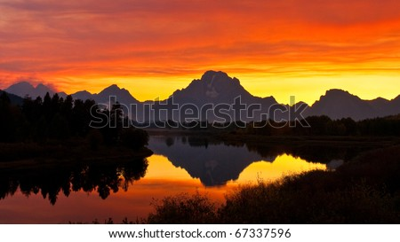 Smoke from forest fires created intense sunset colors at Oxbow Bend on the Snake River.  Grand Teton National Park, Wyoming.