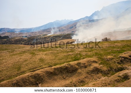 Smoke from grass burning near Mount Aso, Japan